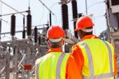 Electrical engineers in substation — Stock Photo