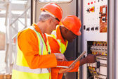Industrial technicians checking transformer — Stock Photo