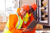 Engineer with co-worker in substation — Stock Photo