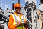 Young african electrical engineer holding clipboard — Stock Photo