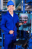 Industrial electrician with insulation tester — Stock Photo