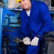 Mechanic repairing factory machine — Stock Photo #59480743