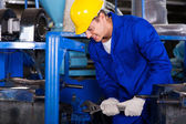 Mechanic repairing factory machine — Stock Photo