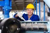 Mechanic repairing machine with spanner — Stock Photo