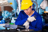 Man working in gumboot factory — Stock Photo