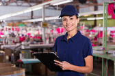 Female factory worker with clipboard — Stock Photo