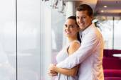 Couple hugging in lounge — Stock Photo