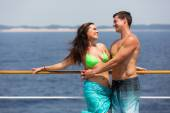Couple in swimsuits hugging on cruise ship — Stock Photo
