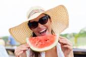 Woman holding slice of watermelon — Stock Photo