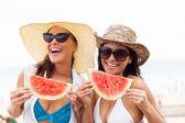 Cheerful women having watermelon — Stock Photo