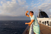 Happy young man enjoying cruise — Stock Photo