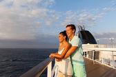 Couple looking at sunrise on cruise ship — Stock Photo