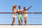 Friends enjoying sunset on cruise — Stock Photo