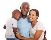 Young african familyp osing — Stock Photo