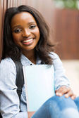 Student sitting outdoors — Stock Photo