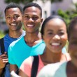 African student standing in a row — Stock Photo #70622459
