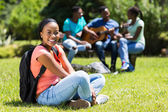 College student sitting outside — Stock Photo
