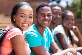 College student with friends on campus — Stock Photo