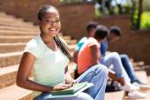 African college girl sitting on steps — Stock Photo