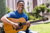 African american man playing guitar — Stock Photo