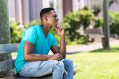 African college student daydreaming — Stock Photo