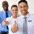 Business group giving thumbs up — Stock Photo #71205699