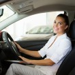 Young businesswoman sitting inside the car — Stock Photo #71209271