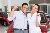 Couple just bought a new car — Stock Photo