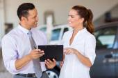 Two car sales consultants working — Stock Photo