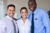 Sales staff at a car dealership — Stock Photo