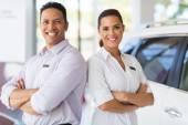 Sales staff standing in vehicle showroom — Stock Photo