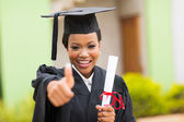 African female graduate giving thumb up  — Stock Photo