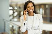 Young businesswoman talking on mobile phone — Stock Photo