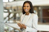 Black businesswoman with smart phone  — Stock Photo