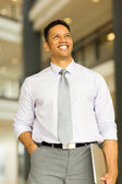 Business man standing in modern office — Stock Photo