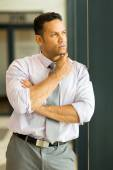 Thoughtful businessman in office — Stock Photo
