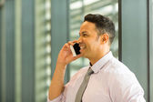 Business executive talking on mobile phone — Stock Photo