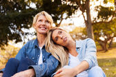 Daughter and mother daydreaming — Stock Photo