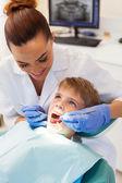 Dentist examining little patient — Stock Photo