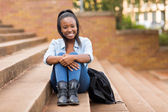 College girl sitting outdoors — Stock Photo