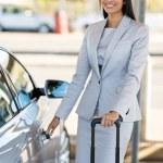 Businesswoman opening car door — Stock Photo #77977032