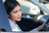 Indian woman driving her new car — Stock Photo