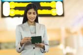 Businesswoman checking her flight ticket — Stock Photo