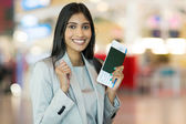 Indian woman holding passport — Stock Photo
