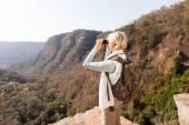 Woman on mountain with binoculars — Stock Photo
