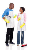 Couple holding cleaning tools — Stock Photo