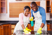 Couple cleaning in kitchen — Stock Photo