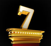 Number Seven on golden platform — Stock Photo
