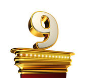 Number Nine on a golden platform over white — Stock Photo