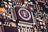 MARCH 16, 2015: Illustration of a spying CPU inside a computer with the NSA logo on it. — Stock Photo